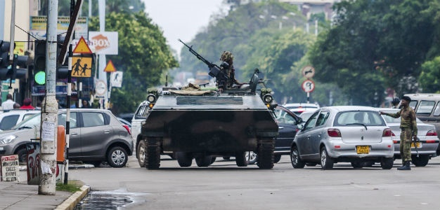An armoured personnel carrier stations by an intersection as Zimbabwean soldiers regulate traffic in Harare on November 15, 2017. (AFP)