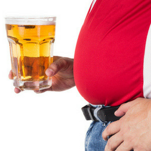 Obese man with beer in his hand