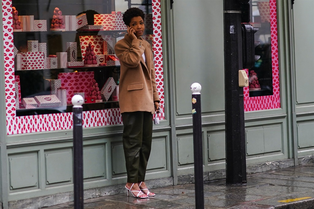 PARIS, FRANCE - MARCH 01: A guest wears a brown wo