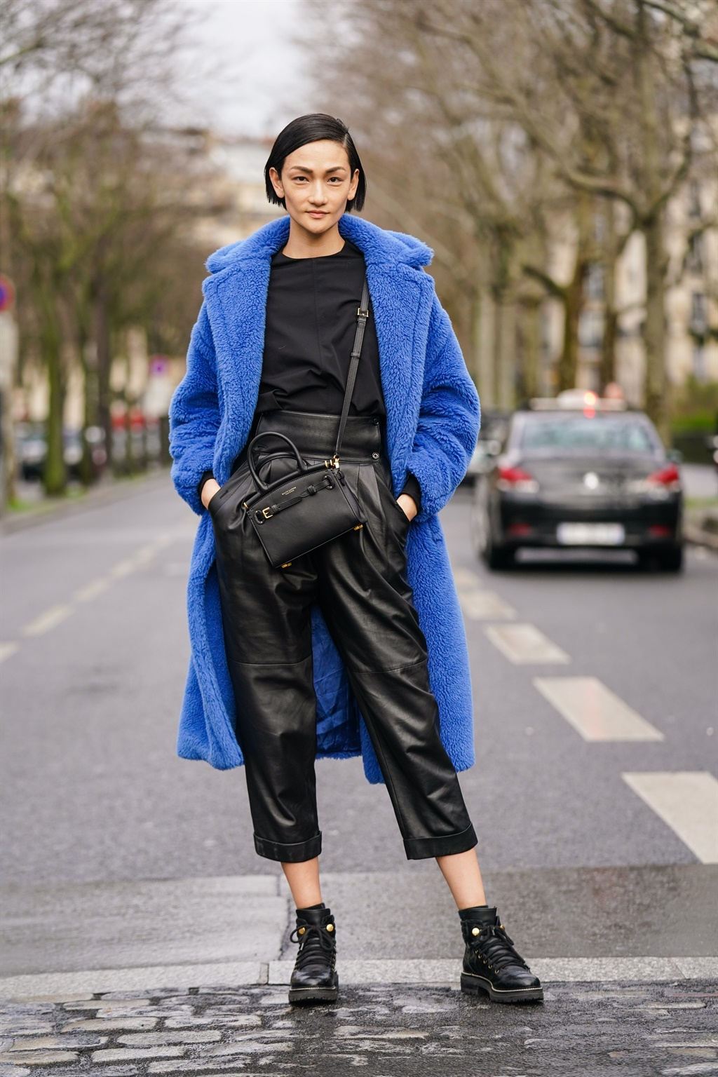 PARIS, FRANCE - MARCH 02: Ai Tominaga wears a blue