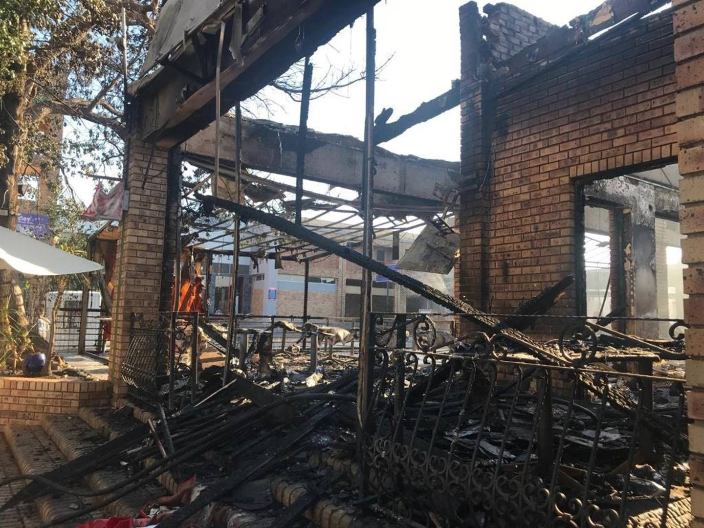 What is left of nine stores after fire broke out on Saturday afternoon at Mutual Mews shopping centre in Rivonia. Picture: Msindisi Fengu/City Press