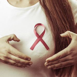 Woman wearing a breast cancer ribbon
