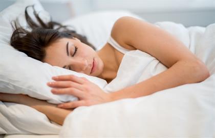 woman sleeping on white pillow