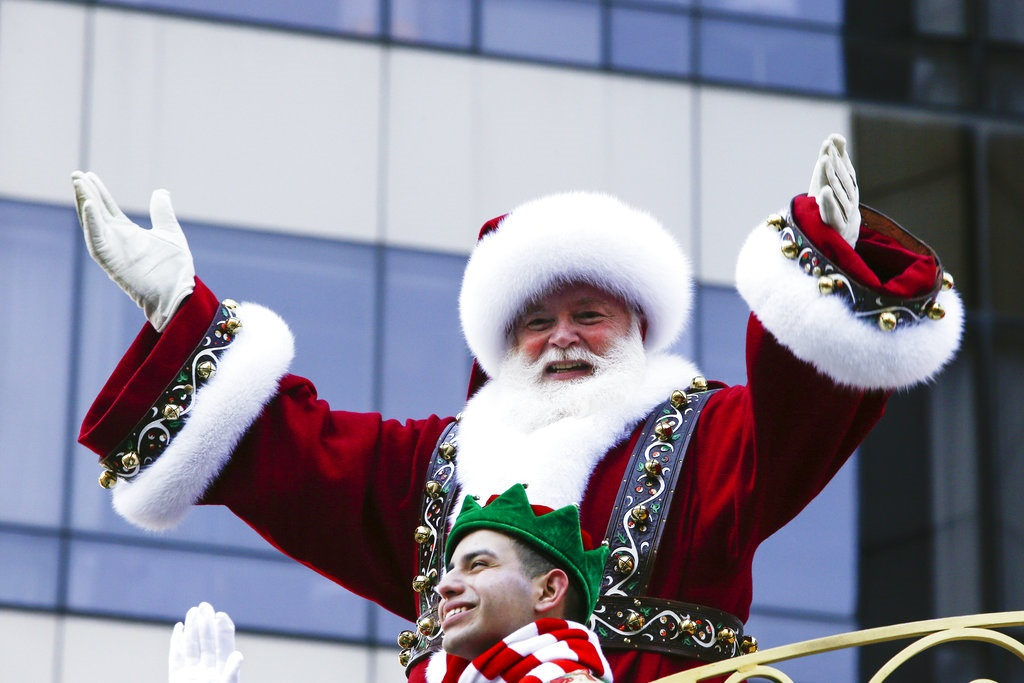 Santa Claus waves to the crowd during the 92nd ann