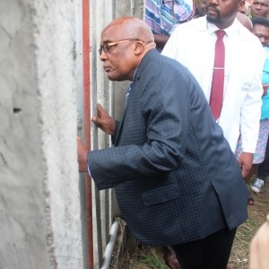 Minister of Health assessing a security fence wher