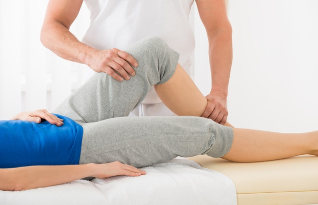 woman having therapy on knee