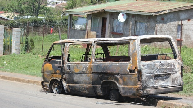 One of the minibus taxis that were torched in Edendale as taxi violence flared up on the weekend.