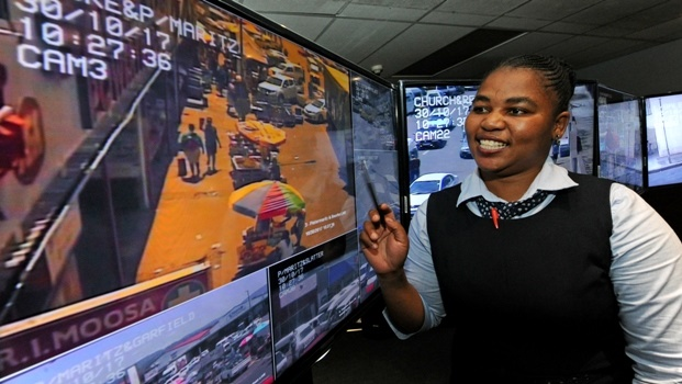 CCTV operator at Safe City, Ntombi Mkhize, analyses video footage in their control room. Their surveillance led to 19 arrests this past weekend.