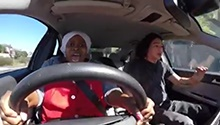 WATCH: Driving Miss Caroline - helper's hilarious, inspiring first experience behind the wheel