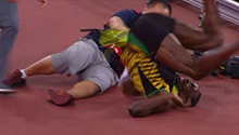 WATCH: This is how you stop Usain Bolt! A cameraman sent Bolt flying during his 200m victory lap
