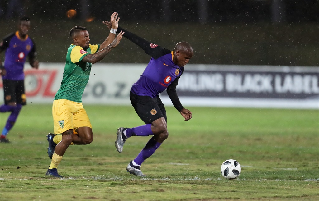 Lebogang Manyama of Kaizer Chiefs is challenged by