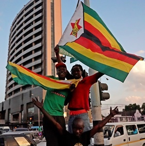 Car horns blared and cheering crowds raced through the streets of the Zimbabwean capital Harare as news spread that President Robert Mugabe, 93, had resigned after 37 years in power. (Marco Longari/AFP)