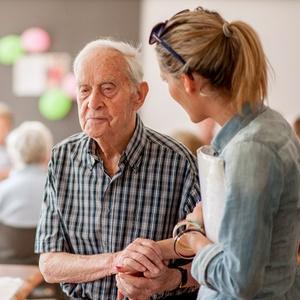 Woman taking care of elderly man