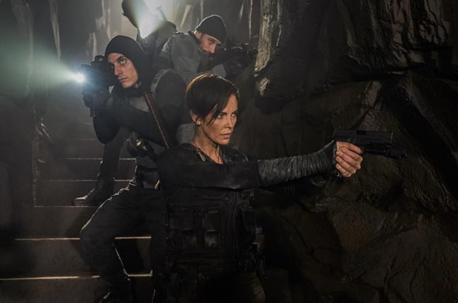 Charlize Theron, Luca Marinelli, Marwan Kenzari and Matthias Schoenaerts in The Old Guard.