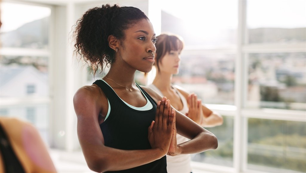 Women stretching and practices yoga in class. Heal