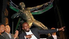 Usain Bolt honoured with statue at stadium where it all began