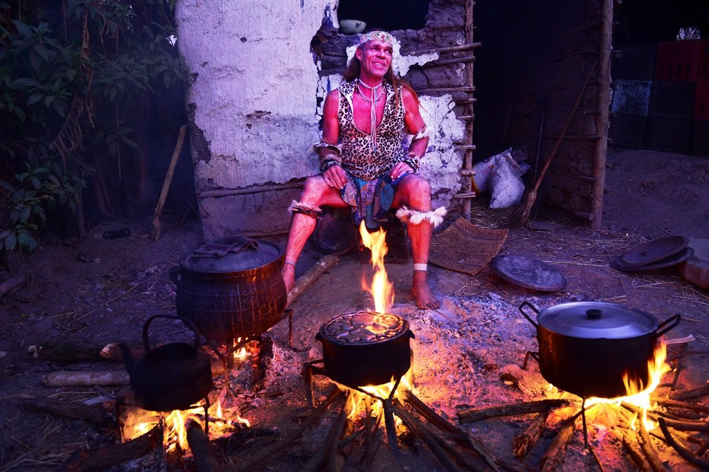 Ntombemhlophe sits next to the fire at his homestead in Lusikisiki Picture: Leon Sadiki/City Press