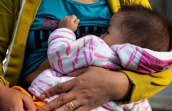 PLEIKU, VIETNAM - 2018/10/04: Mother breastfeeding
