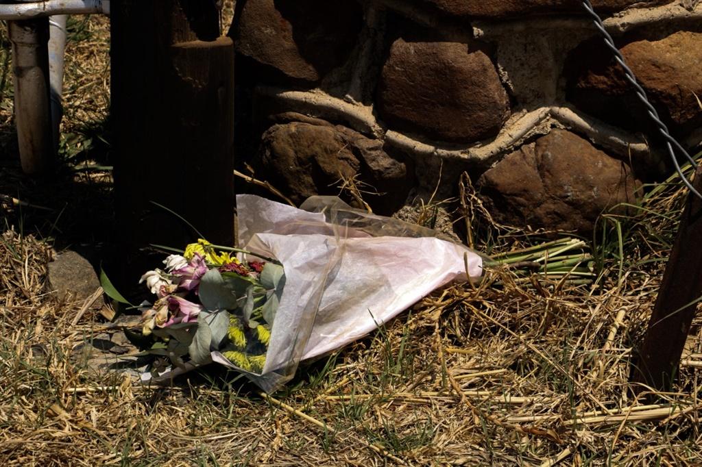 Flowers mark the spot where murdered 21-year-old Brendin Horner's body was found.