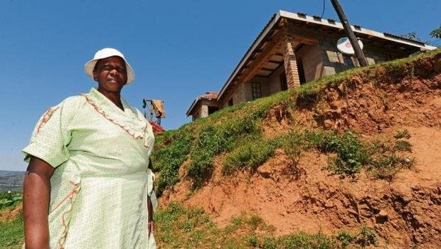 Winnie Gazu says that earthworks to build her RDP house commenced four years ago, but the house was never built. She is now left with a steep bank in front of her property.
