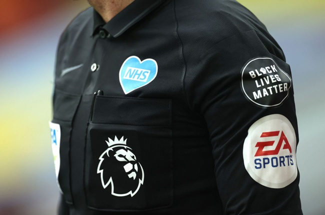 A Black Lives Matter and NHS logo is seen on a officials uniform during a Premier League match (Getty Images)