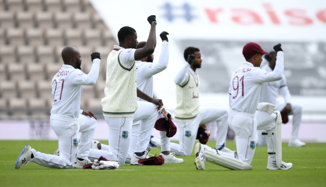 West Indies captain Jason Holder and his teammates take a knee during day one of the 1st #RaiseTheBat Test match. (Photo by Mike Hewitt/Getty Images)