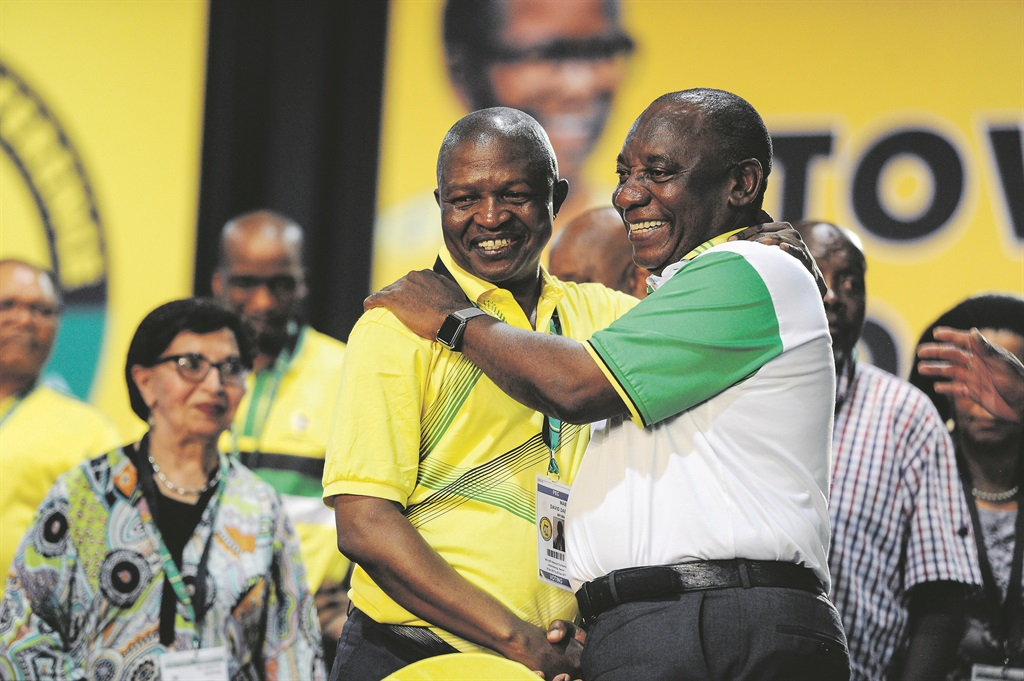 President Cyril Ramaphosa and Deputy President David Mabuza congratulate each other at the ANC's Nasrec conference. Photo: Felix Dlangamand