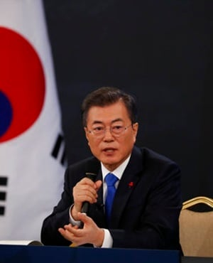 South Korean President Moon Jae-in answers reporters' question during his New Year news conference at the Presidential Blue House in Seoul on January 10. (Kim Hong-Ji, Pool Photo via AP)