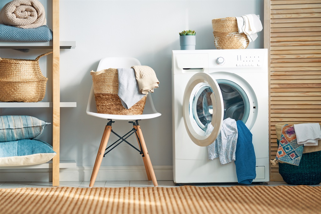 Interior of a real laundry room with a washing mac