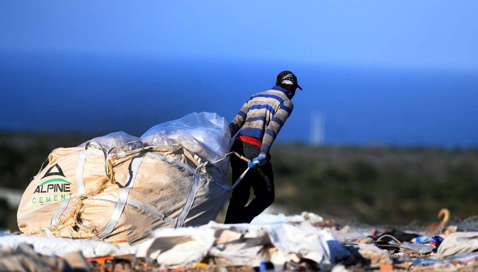 The daily toil. A waste picker makes his way home from the Arlington landfill site in Port Elizabeth. Picture: Black Star/Spotlight