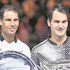 THE BEST:  Roger Federer poses with the Australian Open winner's trophy alongside runner-up Rafael Nadal, after their epic final in Melbourne last year. (Kyodo News, Getty Images).