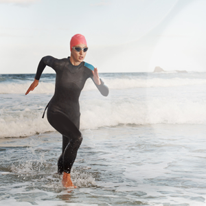 Triathlete coming out of the swim