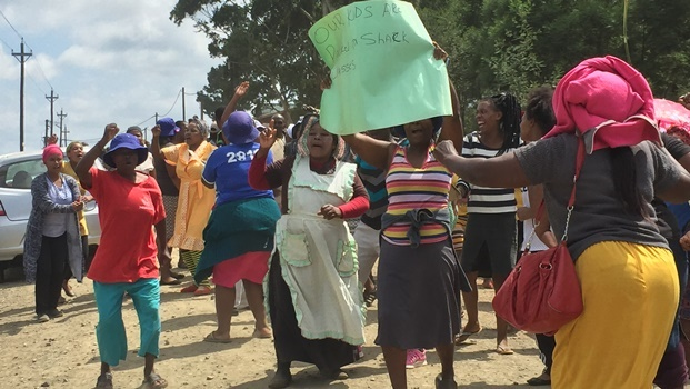 Parents protesting outside Umsilinga Primary School on Monday. They want answers on why a new building is not in use yet.