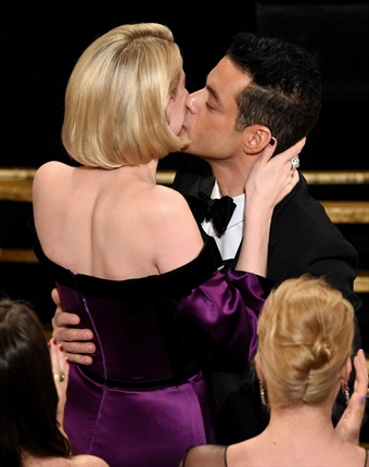 A quick moment for Rami and Lucy, the woman who captured his heart.