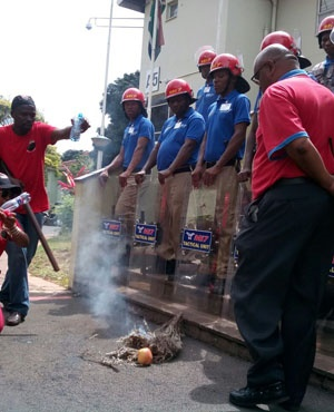 Striking DUT staff burn incense in front of the university's Vice Chancellor's office. (File, Mxolisi Mngadi, News24)