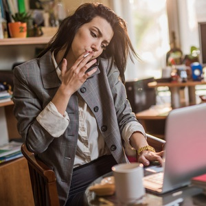 Woman smoking at her desk