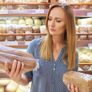 woman shopping for bread