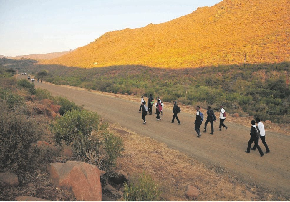 Pupils from GaSekele and surrounding villages in the Leolo and Schoonoord areas of Sekhukhune in Limpopo walk for at least two hours to get to school on time. Because many live within a 5km radius, they don't qualify for the national scholar transport programme. Picture: Lucas Ledwaba / Mukurukuru Media