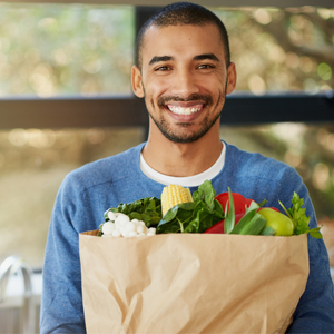 Man holding bag of healthy food