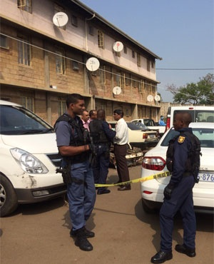 Police officers at the scene of the KwaMashut shooting. (Jeff Wicks, News24)