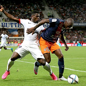 Souleymane Camara battles for the ball with Serge Aurier during French Ligue 1 between Paris Saint Germain (PSG) and Montpeller Heraultat Stade de la Mosson on August 21, 2015 in Montpellier, France.