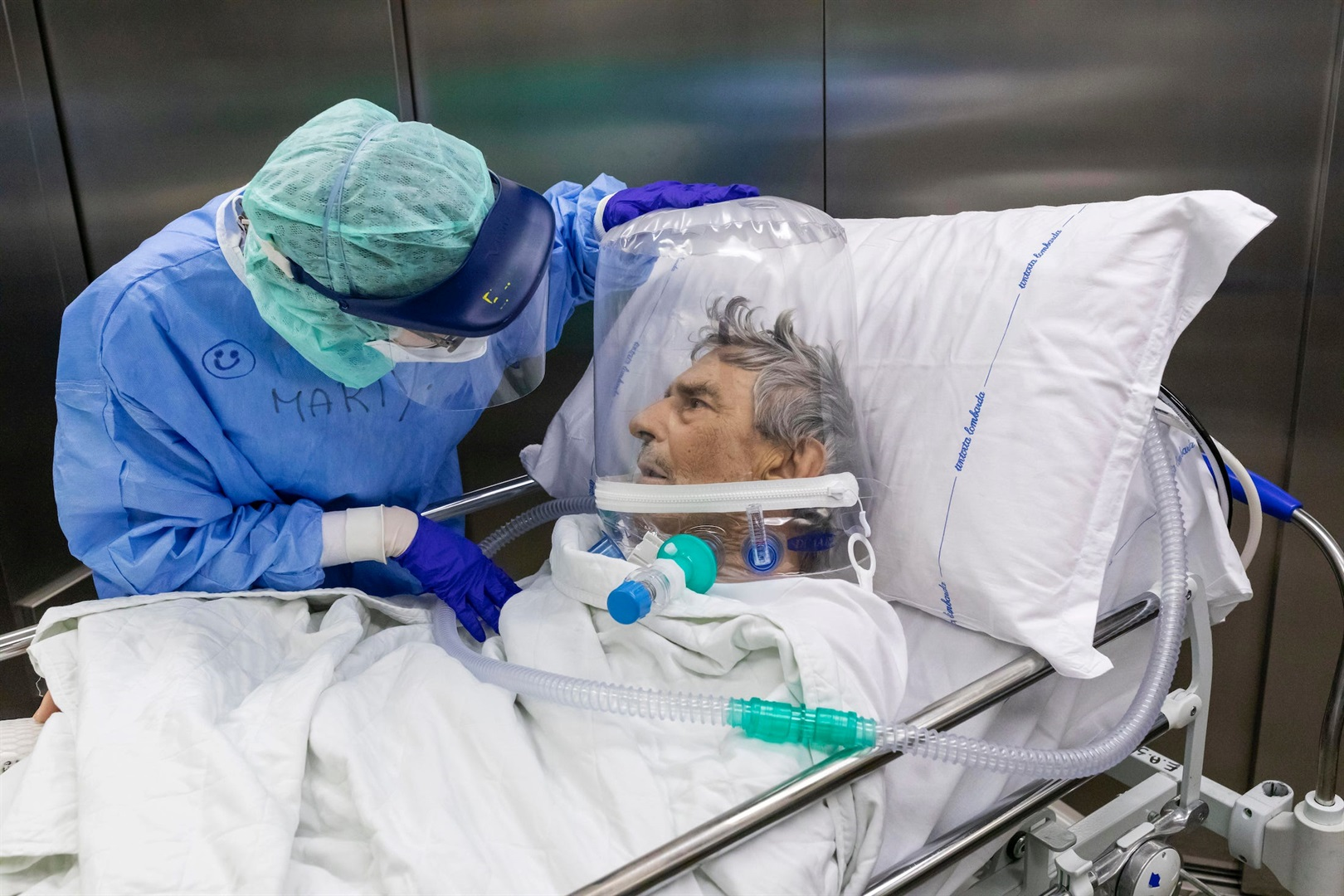 A nurse attends to a Covid-19 patient after he was moved out of the ICU of Pope John XXIII Hospital in Bergamo, Italy, on April 7, 2020.