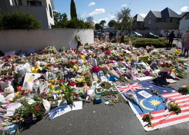Flowers are placed outside the Al Noor mosque in C