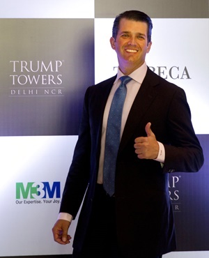 The eldest son of US President Donald Trump, Donald Trump Junior. gives a thumbs up as he arrives in India to help sell luxury apartments in a string of Trump-branded developments. (Manish Swarup, AP)