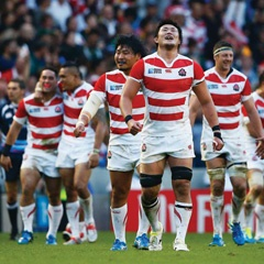 Japan's players celebrate their historic, surprise victory over the Springboks in their rugby World Cup opening match at the Brighton Community Stadium yesterday. Picture: Julian Finney / Getty Images