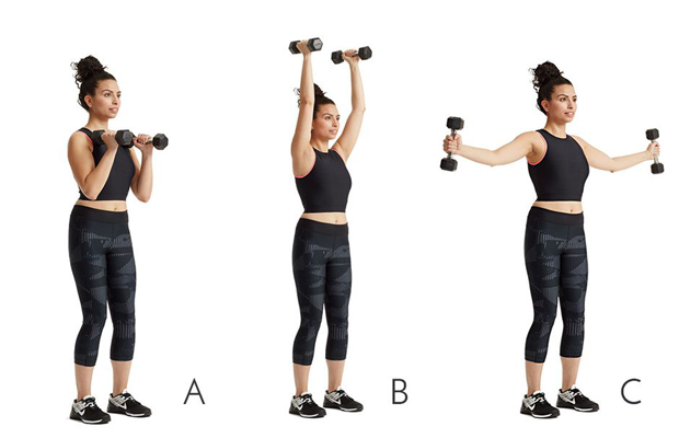 woman performing dumbell press