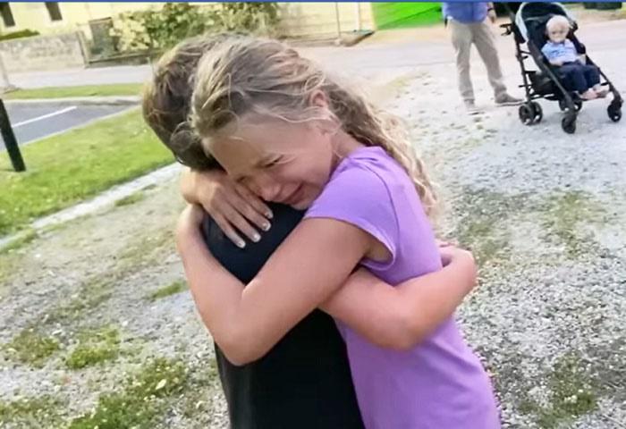 children hug after long absence