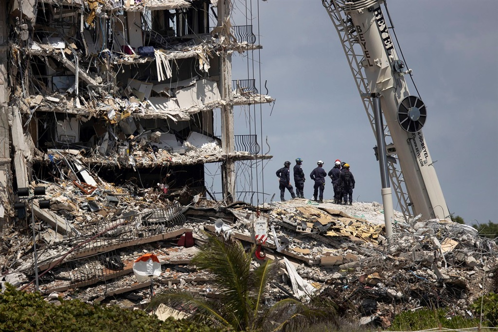 Search-and-rescue teams look for possible survivors in the partially collapsed 12-story Champlain Towers South condo building on June 27, 2021, in Surfside, Florida. # Joe Raedle/Getty