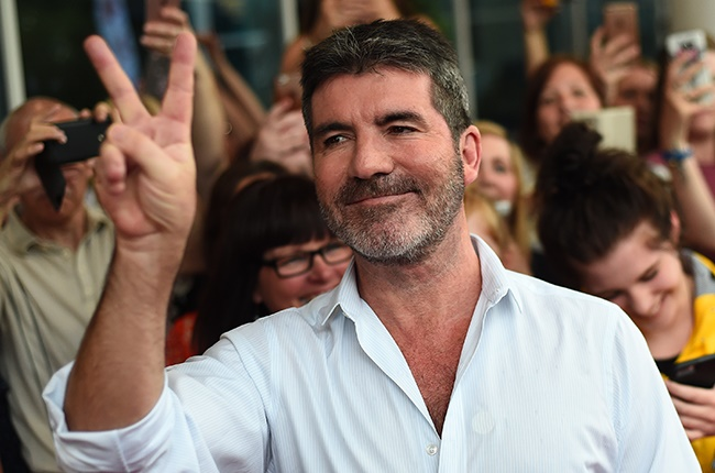 Simon Cowell in hospital after breaking his back - News24