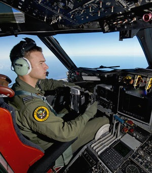 A Royal Australian Air Force pilot flies his AP-3C Orion over the Southern Indian Ocean during the search for missing Malaysian Airlines flight MH370. Two objects possibly related to the search have been found. (Sgt Hamish Paterson, Australian Defenc